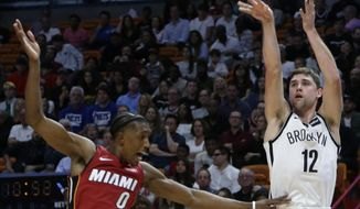 Brooklyn Nets' Joe Harris (12) is fouled by Miami Heat's Josh Richardson (0) while attempting a 3-point basket during the first half of an NBA basketball game Friday, Dec. 29, 2017, in Miami. (AP Photo/Lynne Sladky)