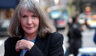 FILE - In this Oct. 15, 2002 file photo, mystery writer Sue Grafton poses for a portrait in New York. Grafton has died in Santa Barbara, Calif., at the age of 77. Her daughter, Jamie Clark says her mother passed away Thursday night, Dec. 28, 2017, after a two-year battle with cancer and was surrounded by family.  (AP Photo/Gino Domenico, file)