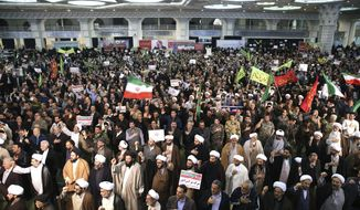 Iranian protesters chant slogans at a rally in Tehran, Iran, Saturday, Dec. 30, 2017. Iranian hard-liners rallied Saturday to support the country's supreme leader and clerically overseen government as spontaneous protests sparked by anger over the country's ailing economy roiled major cities in the Islamic Republic. (AP Photo/Ebrahim Noroozi)