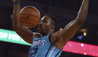 Charlotte Hornets' Dwight Howard scores against the Golden State Warriors during the first half of an NBA basketball game Friday, Dec. 29, 2017, in Oakland, Calif. (AP Photo/Ben Margot)