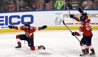 Florida Panthers' Connor Brickley (23) celebrates after scoring a goal against the Montreal Canadiens as teammates Denis Malgin (62), of Switzerland, and Vincent Trocheck, top right, follow during the second period of an NHL hockey game, Saturday, Dec. 30, 2017, in Sunrise, Fla. (AP Photo/Luis M. Alvarez)