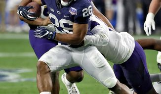 Penn State running back Saquon Barkley (26) runs against Washington during the second half of the Fiesta Bowl NCAA college football game, Saturday, Dec. 30, 2017, in Glendale, Ariz. (AP Photo/Rick Scuteri)