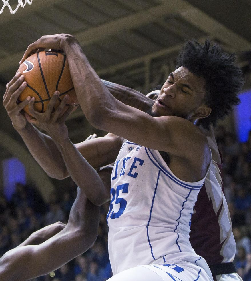 Duke's Marvin Bagley III (35) battles for a rebound during the first half of an NCAA college basketball game against Florida State in Durham, N.C., Saturday, Dec. 30, 2017. (AP Photo/Ben McKeown)