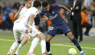 FILE - A Sunday, Oct. 22, 2017 file photo showing PSG's Neymar, right, challenging for the ball with Marseille's Hiroki Sakai, left, and Marseille's Florian Thauvin, during the League One soccer match between Marseille and Paris Saint-Germain, at the Velodrome stadium, in Marseille. The biggest statement came from PSG which more than doubled the previous transfer record by splurging 222 million euros on Neymar _ an unexpected windfall for Barcelona but a deal that solidified the power shifts. (AP Photo/Claude Paris, File)