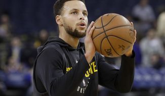 Golden State Warriors guard Stephen Curry warms up before the team's NBA basketball game against the Memphis Grizzlies in Oakland, Calif., Saturday, Dec. 30, 2017. Curry is returning to the court Saturday night against the Grizzlies after missing 11 games with a sprained right ankle. (AP Photo/Jeff Chiu)