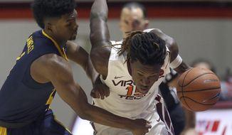 Chris Clarke (15) of Virginia Tech drives past North Carolina A&T's Kameron Langley (4) in the second half of an NCAA college basketball game in Blacksburg Va. Thursday Dec. 28 2017. (Matt Gentry/The Roanoke Times via AP)