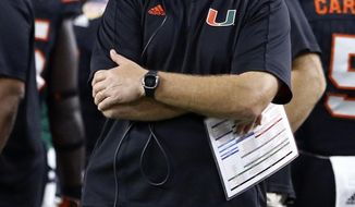 Miami head coach Mark Richt watches the game during the first half of the Orange Bowl NCAA college football game against Wisconsin, Saturday, Dec. 30, 2017, in Miami Gardens, Fla. (AP Photo/Joe Skipper)