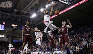 Gonzaga guard Silas Melson (0) dunks during the first half of an NCAA college basketball game against Santa Clara in Spokane, Wash., Saturday, Dec. 30, 2017. (AP Photo/Young Kwak)