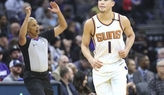 Phoenix Suns guard Devin Booker (1) reacts after hitting a three-point shot during the first half of an NBA basketball game against the Sacramento Kings in Sacramento, Calif., Friday, Dec. 29, 2017. (AP Photo/Steve Yeater)