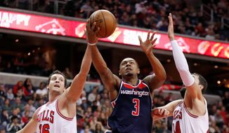 Washington Wizards guard Bradley Beal scored 39 points, but was disappointed with himself for missing two free throws in a 114-110 victory over the Chicago Bulls on Sunday. (Associated Press)