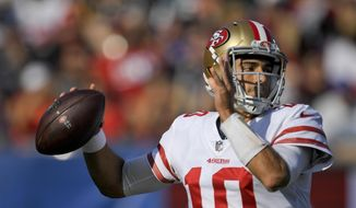 San Francisco 49ers quarterback Jimmy Garoppolo passes against the Los Angeles Rams during the first half of an NFL football game, Sunday, Dec. 31, 2017, in Los Angeles. (AP Photo/Mark J. Terrill) **FILE**