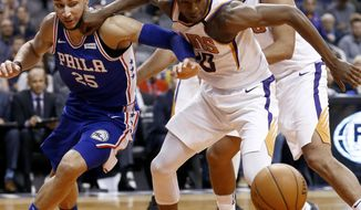 Phoenix Suns forward Josh Jackson, front right, battles with Philadelphia 76ers guard Ben Simmons (25) for a loose ball as Suns forward Jared Dudley, back right, watches during the first half of an NBA basketball game Sunday, Dec. 31, 2017, in Phoenix. (AP Photo/Ross D. Franklin)