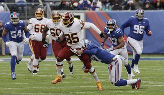 Washington Redskins tight end Vernon Davis (85) breaks a tackle by New York Giants' Darian Thompson (27) during the first half of an NFL football game Sunday, Dec. 31, 2017, in East Rutherford, N.J. (AP Photo/Mark Lennihan)