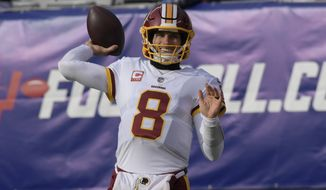 Washington Redskins quarterback Kirk Cousins (8) throws a pass before an NFL football game against the New York Giants Sunday, Dec. 31, 2017, in East Rutherford, N.J. (AP Photo/Bill Kostroun)