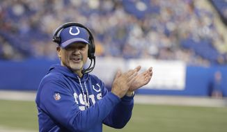 Indianapolis Colts head coach Chuck Pagano applauds during the second half of an NFL football game against the Houston Texans, Sunday, Dec. 31, 2017, in Indianapolis. Indianapolis won 22-13. (AP Photo/Darron Cummings)