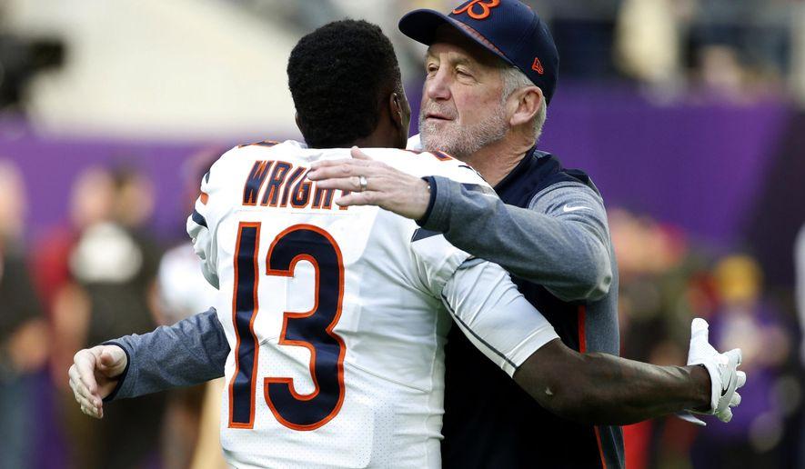Chicago Bears head coach John Fox hugs wide receiver Kendall Wright (13) before an NFL football game against the Minnesota Vikings, Sunday, Dec. 31, 2017, in Minneapolis. (AP Photo/Bruce Kluckhohn)