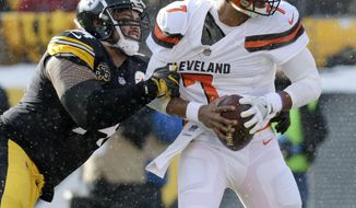 Cleveland Browns quarterback DeShone Kizer (7) is sacked by Pittsburgh Steelers defensive end Tyson Alualu (94) during the first half of an NFL football game in Pittsburgh, Sunday, Dec. 31, 2017. (AP Photo/Don Wright)