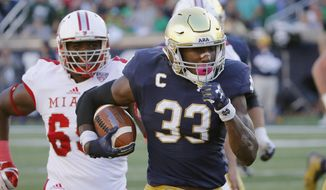 FILE - In this Sept. 30, 2017, file photo, Notre Dame running back Josh Adams (33) heads for the end zone for his second touchdown of the game during the first half of an NCAA college football game against Miami (Ohio) in South Bend, Ind. Running backs will take center stage as No. 14 Notre Dame faces No. 16 LSU in the Citrus Bowl. The Irish's Josh Adams is 13th nationally in rushing while the Tigers' Derrius Guice has posted his second straight 1,000-yard season. (AP Photo/Charles Rex Arbogast, File)