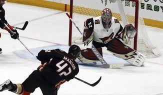 Arizona Coyotes goalie Antti Raanta (32) blocks a shot by Anaheim Ducks defenseman Josh Manson (42) in the first period of an NHL hockey game in Anaheim, Calif., Sunday, Dec. 31, 2017. (AP Photo/Reed Saxon)