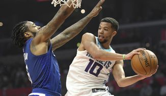 Charlotte Hornets guard Michael Carter-Williams (10) is challenged under the basket by Los Angeles Clippers center DeAndre Jordan during the first half of an NBA basketball game, Sunday, Dec. 31, 2017, in Los Angeles. (AP Photo/Michael Owen Baker)