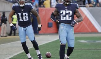 Tennessee Titans running back Derrick Henry (22) celebrates with wide receiver Rishard Matthews (18) after Henry scored a touchdown on a 66-yard pass play against the Jacksonville Jaguars in the first half of an NFL football game Sunday, Dec. 31, 2017, in Nashville, Tenn. (AP Photo/James Kenney)