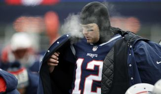 New England Patriots quarterback Tom Brady puts on a coat on the sideline during the first half of an NFL football game against the New York Jets, Sunday, Dec. 31, 2017, in Foxborough, Mass. (AP Photo/Charles Krupa)