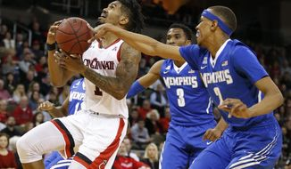 Memphis forward Jimario Rivers (2) knocks the ball from the hands of Cincinnati guard Jacob Evans (1) during the first half of an NCAA college basketball game, Sunday, Dec. 31, 2017, in Highland Heights, Ky. (AP Photo/Gary Landers)