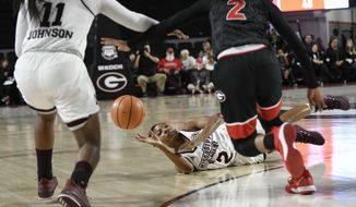 Mississippi State guard Morgan William passes from the floor to guard Roshunda Johnson (11) as Georgia guard Gabby Connally (2) defends during the second half of an NCAA college basketball game Sunday, Dec. 31, 2017, in Athens, Ga. (AP Photo/John Amis)