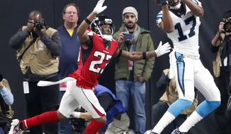 Carolina Panthers wide receiver Devin Funchess (17) makes a touchdown catch in the end zone against Atlanta Falcons cornerback Robert Alford (23) during the first half of an NFL football game, Sunday, Dec. 31, 2017, in Atlanta. (AP Photo/John Bazemore)
