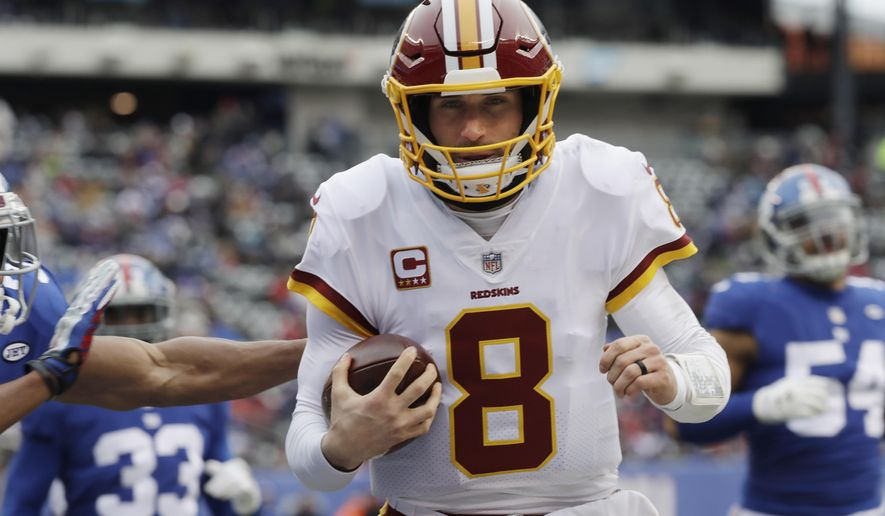 Washington Redskins quarterback Kirk Cousins (8) rushes for a touchdown during the first half of an NFL football game against the New York Giants, Sunday, Dec. 31, 2017, in East Rutherford, N.J. (AP Photo/Mark Lennihan)
