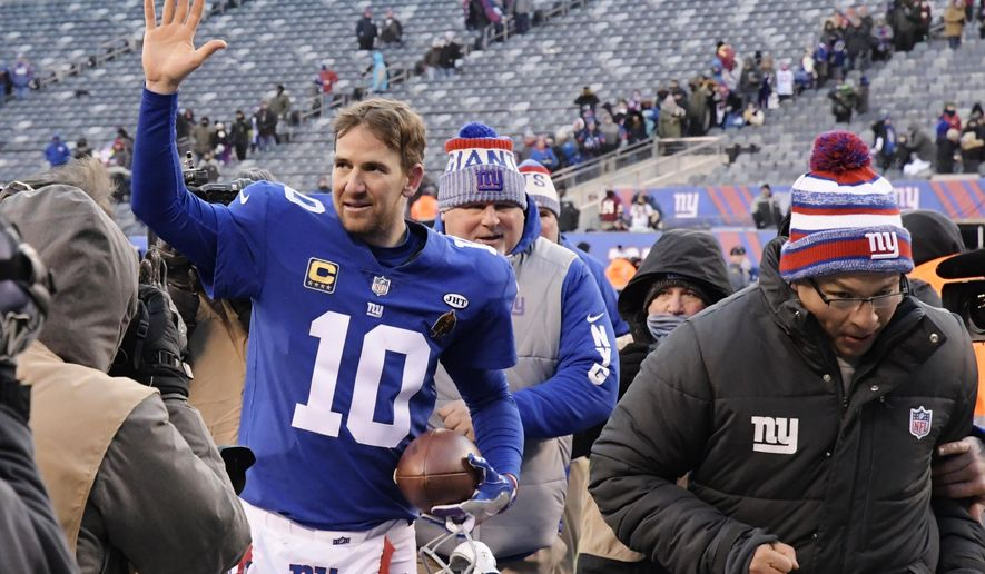 New York Giants quarterback Eli Manning (10) waves to fans after an NFL football game against the Washington Redskins, Sunday, Dec. 31, 2017, in East Rutherford, N.J. The Giants won 18-10. (AP Photo/Bill Kostroun)