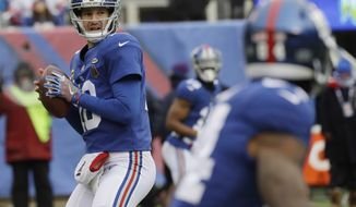 New York Giants quarterback Eli Manning (10) looks to pass during the first half of an NFL football game against the Washington Redskins, Sunday, Dec. 31, 2017, in East Rutherford, N.J. (AP Photo/Mark Lennihan)