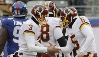 Washington Redskins' Dustin Hopkins (3) and Tress Way (5) celebrate after Hopkins kicked a field goal during the first half of an NFL football game against the New York Giants Sunday, Dec. 31, 2017, in East Rutherford, N.J. (AP Photo/Mark Lennihan) **FILE**