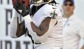 New Orleans Saints' Alvin Kamara (41) takes the kickoff from the Tampa Bay Buccaneers 106-yards for a touchdown during the first half of an NFL football game Sunday, Dec. 31, 2017, in Tampa, Fla. (AP Photo/Steve Nesius)