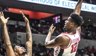 Mississippi's Bruce Stevens (12) shoots against South Carolina's Chris Silva (30) during an NCAA college basketball game in Oxford, Miss., Sunday, Dec. 31, 2017. (Bruce Newman/The Oxford Eagle via AP)
