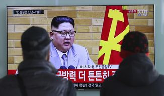 "South Koreans watch a TV news program showing North Korean leader Kim Jong Un's New Year's speech, at the Seoul Railway Station in Seoul, South Korea, Monday, Jan. 1, 2018. The letters read on top left, ""Kim Jong Un delivers New Year's speech."" Kim said the United States should be aware that his country's nuclear forces are now a reality, not a threat. (AP Photo/Lee Jin-man)"