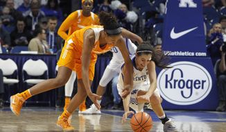 Tennessee's Jaime Nared, left, battles for the ball with Kentucky's Maci Morris during an NCAA college basketball game in Lexington, Ky., Sunday, Dec. 31, 2017. (AP Photo/Matt Goins)