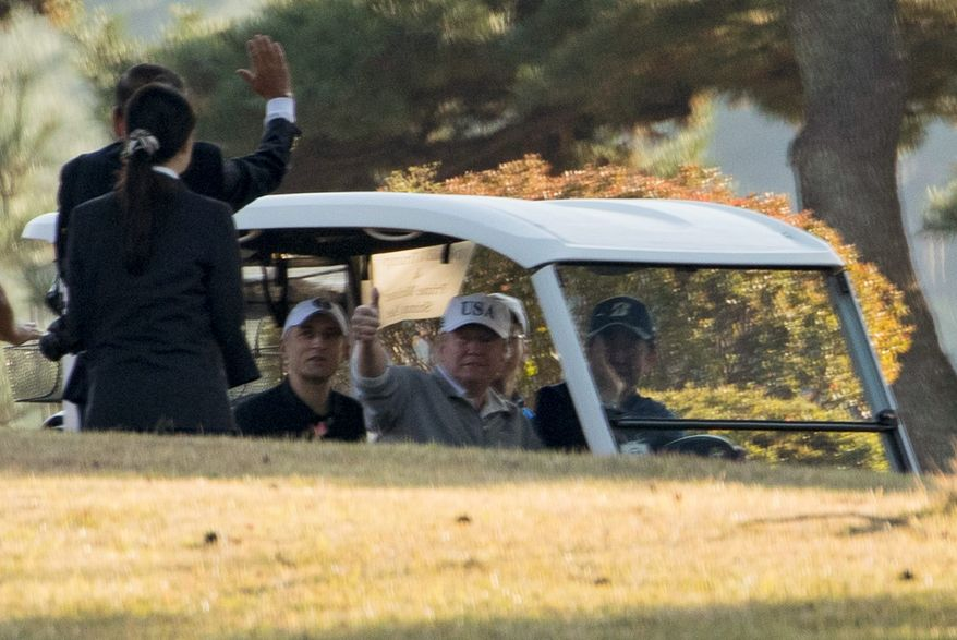 President Trump has played golf twice with Japanese Prime Minister Shinzo Abe (right) and 39 confirmed rounds overall in his first year in office. (Associated Press)