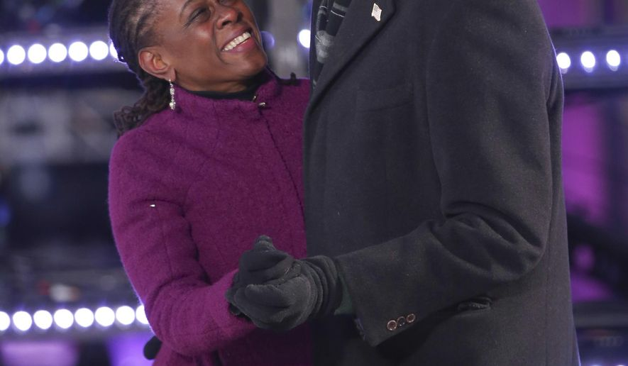 Chirlane McCray, left, and New York City Mayor Bill de Blasio dance on stage at the New Year's Eve celebration in Times Square on Sunday, Dec. 31, 2017, in New York. (Photo by Brent N. Clarke/Invision/AP)