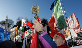 A man holds the ANPI (Italian Partisans Association) flag during a demonstration staged by the Democratic party, in Como, Italy, Saturday, Dec. 9, 2017. Italys governing Democrats have led a rally to warn about fascisms making a comeback in the nation, which had suffered under fascist dictator Benito Mussolini.vSeveral thousand people turned out in Como, northern Italy, where recently right-wing extremists interrupted an NGO meeting about migrants housing. Earlier this week, a neo-fascist party attacked the Rome office of a liberal newspaper. (AP Photo/Luca Bruno)