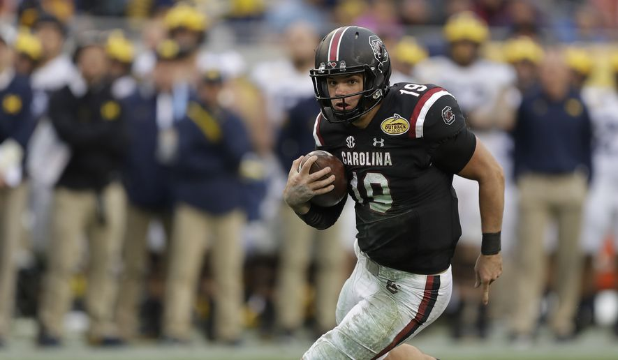 South Carolina quarterback Jake Bentley runs for yardage against Michigan during the second half of the Outback Bowl NCAA college football game Monday, Jan. 1, 2018, in Tampa, Fla. South Carolina won the game 26-19. (AP Photo/Chris O'Meara)