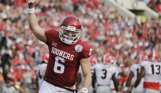 Oklahoma quarterback Baker Mayfield celebrates after running back Rodney Anderson scored a touchdown against Georgia during the first half of the Rose Bowl NCAA college football game Monday, Jan. 1, 2018, in Pasadena, Calif. (AP Photo/Jae C. Hong) **FILE**