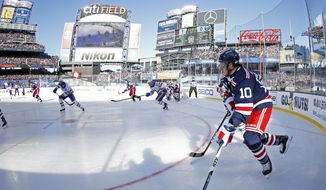 New York Rangers left wing J.T. Miller (10) controls the puck against the Buffalo Sabres in the first period of the NHL Winter Classic hockey game at CitiField in New York on Monday, Jan. 1, 2018. The Rangers won 3-2 in overtime. (AP Photo/Adam Hunger)