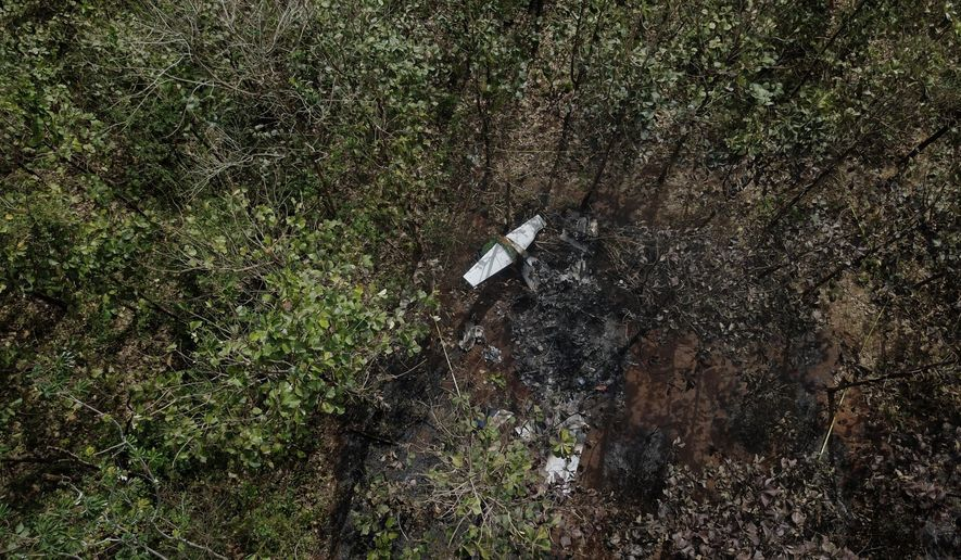 The burnt wreckage of a Nature Air plane is seen in a wooded area in Corozalito de Nandayure, near Punta Islita, Guanacaste province, Costa Rica, Monday, Jan. 1, 2018. Costa Rican investigators are looking into what caused the charter aircraft to crash Sunday shortly after takeoff, killing several, including families from New York and Florida. (AP Photo/Berny Araya)