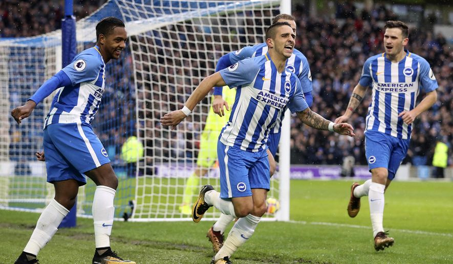 Brighton & Hove Albion's Anthony Knockaert, center, celebrates scoring his side's first goal of the game against AFC Bournemouth during the English Premier League soccer match at the AMEX Stadium, Brighton, Monday Jan. 1, 2018. (Adam Davy/PA via AP)