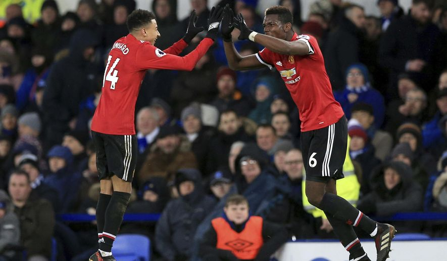 Manchester United's Jesse Lingard, left celebrates scoring his side's second goal of the game, during the English Premier League soccer match between Everton and Manchester United, at Goodison Park, in Liverpool, England, Monday, Jan. 1, 2018. (Peter Byrne/PA via AP)