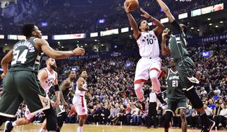Toronto Raptors guard DeMar DeRozan (10) shoots over Milwaukee Bucks forward John Henson (31) during first half NBA basketball action in Toronto on Monday, Jan. 1, 2018. (Frank Gunn/The Canadian Press via AP)