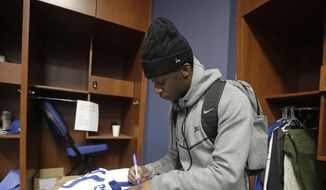 Indianapolis Colts' Johnathan Hankins autographs a jersey after cleaning out his locker at the NFL team's facility, Monday, Jan. 1, 2018, in Indianapolis. (AP Photo/Darron Cummings)
