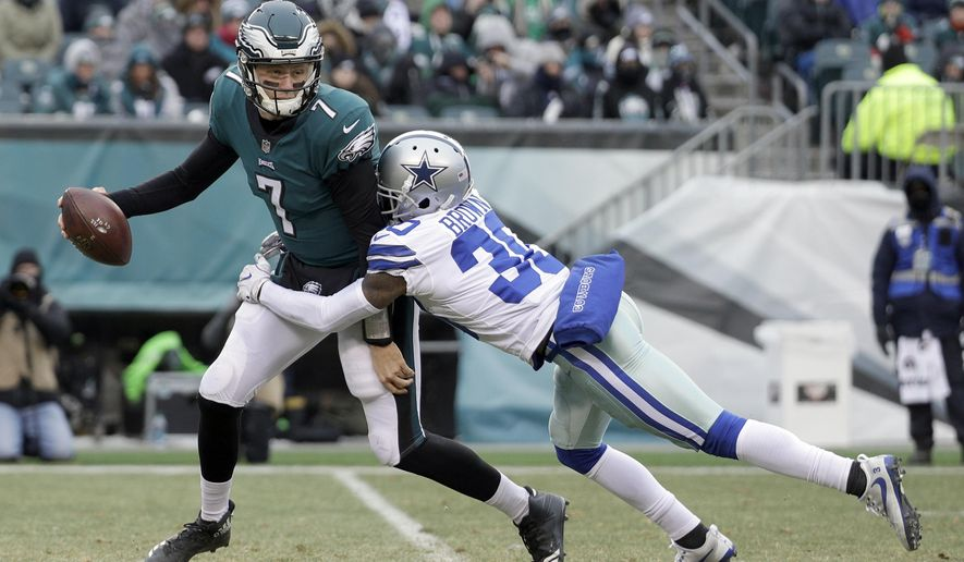 Philadelphia Eagles' Nate Sudfeld, left, is tackled by Dallas Cowboys' Anthony Brown during the second half of an NFL football game, Sunday, Dec. 31, 2017, in Philadelphia. (AP Photo/Chris Szagola)