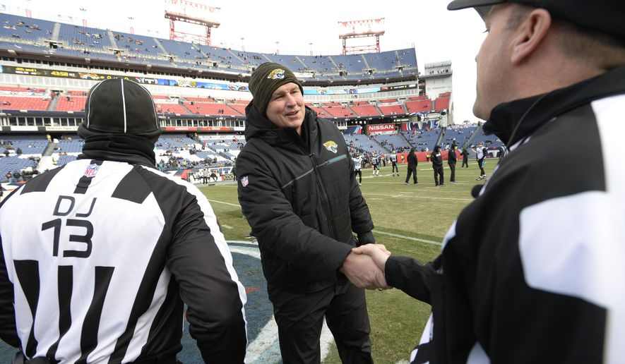 Jacksonville Jaguars head coach Doug Marrone greets officials before an NFL football game between the Jaguars and the Tennessee Titans Sunday, Dec. 31, 2017, in Nashville, Tenn. (AP Photo/Mark Zaleski)